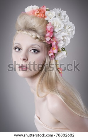 Beautiful young woman with flower