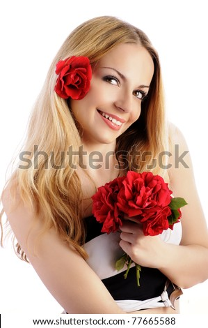 Beautiful young woman with flower in her hair, holding a bouquet of red roses and smiling, isolated on white - stock photo