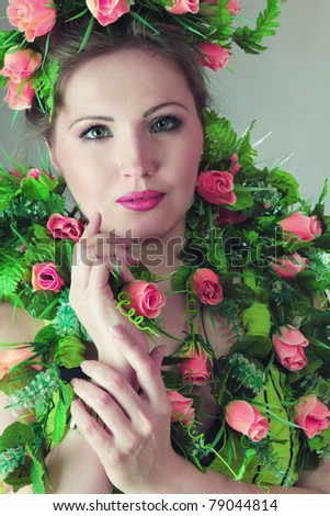 Beautiful young woman with flowers - stock photo