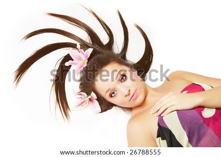 Beautiful young woman with flowers in her hair