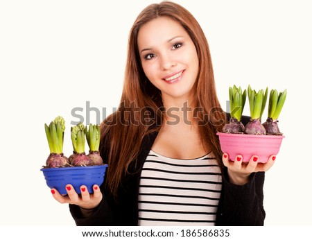 beautiful young woman with flowers in pots, white background - stock photo