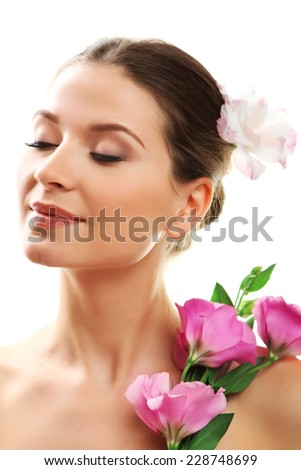 Beautiful young woman with flowers isolated on white