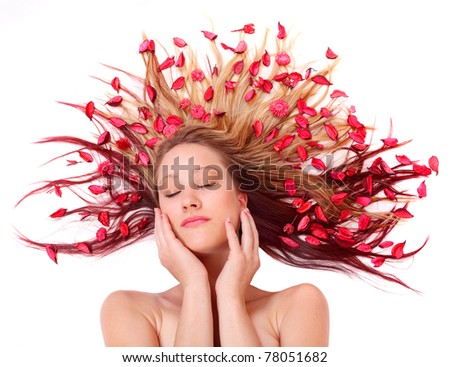 Beautiful young woman with flowers on her long hair. Healthy lifestyle metaphor.