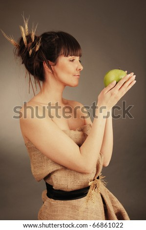 Beautiful young woman with fresh green apple. Nature concept. - stock photo