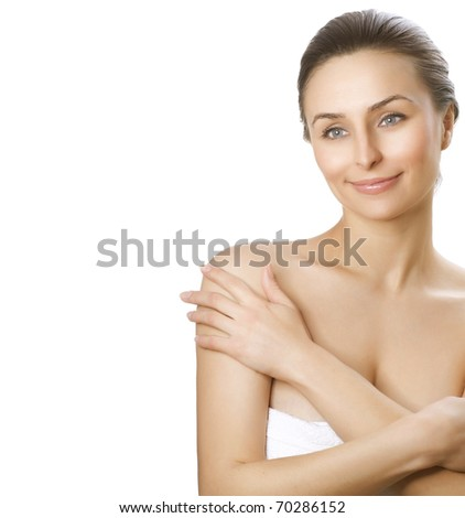 Beautiful Young Woman with fresh healthy skin applying moisturizer.Spa woman concept - stock photo