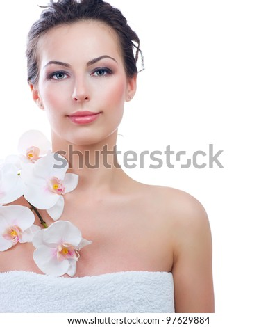 Beautiful Young Woman With Fresh Healthy Skin.Spa.Isolated on a White Background