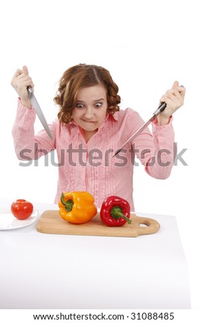 Beautiful young woman with fresh vegetables. Pretty girl with pepper.  Housewife with sweet peppers and knifes. Isolated over white background. - stock photo