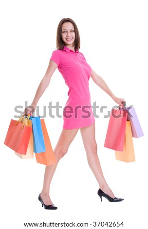 Beautiful young woman with full shopping bags