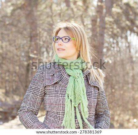 Beautiful Young Woman with glasses Cheerful Lifestyle portrait in nature. Caucasian female autumn winter season clothing outdoor. - stock photo