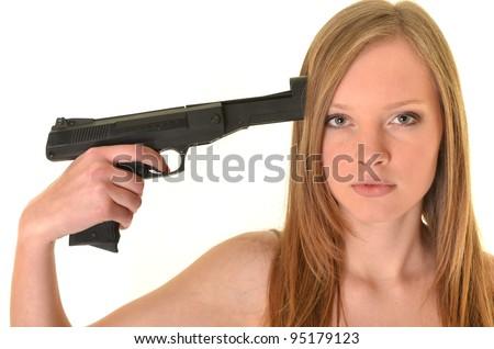 Beautiful young woman with gun - stock photo