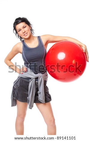 Beautiful young woman with gym ball, isolated on white background - stock photo