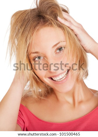 Beautiful young woman with hands touching her hair isolated on white background - stock photo