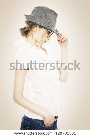 Beautiful Young Woman With Hat and Glasses - stock photo