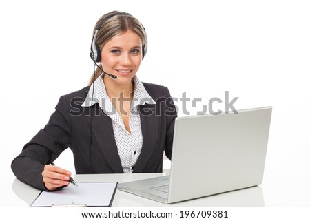 Beautiful young woman with headphones and laptop illustrating business service, on white - stock photo