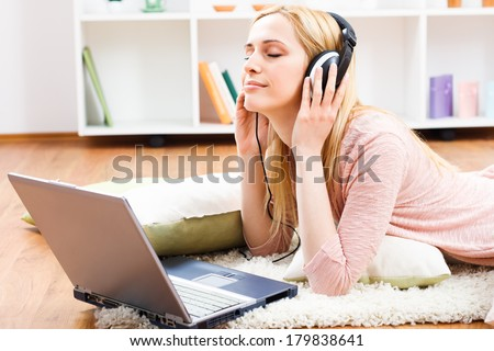Beautiful young woman with headphones enjoys in music,Enjoy music - stock photo