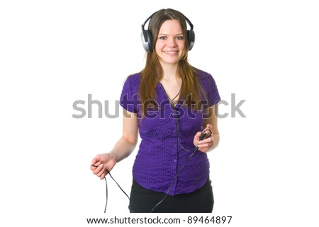 Beautiful young woman with headphones isolated on white background - stock photo
