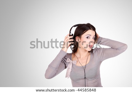 Beautiful young woman with headphones  Listening to Music