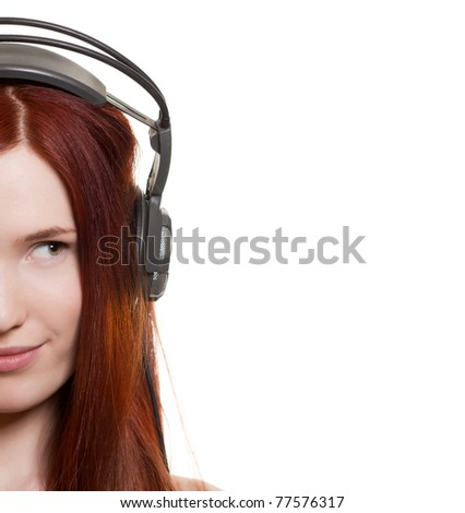 Beautiful young woman with headphones look on copyspace