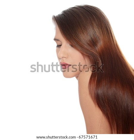 Beautiful young woman with healthy long hair - stock photo