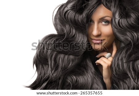 beautiful young woman with healthy long shiny curly hair - stock photo