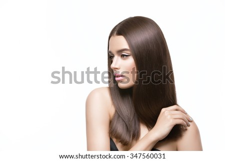 Beautiful young woman with healthy shiny straight hair. Beauty shot. Isolated over white background. Copy space. - stock photo