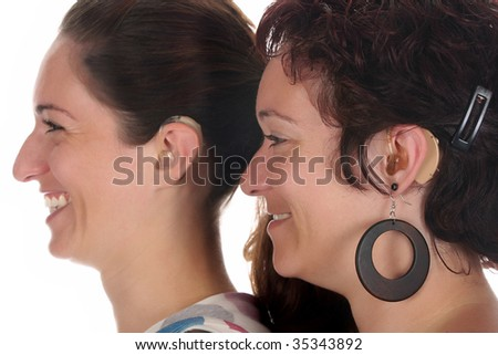 Beautiful young woman with Hearing Aid, closeup shot - stock photo