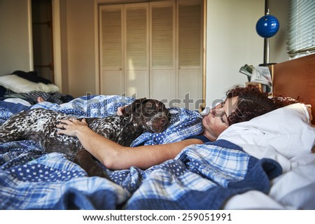 beautiful young woman with her dog - stock photo