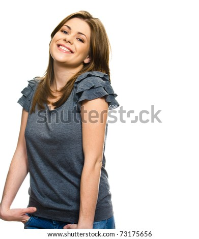 Beautiful young woman with her hands in the pockets of jeans