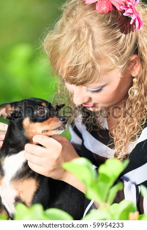 Beautiful young woman with her pet dog outdoor