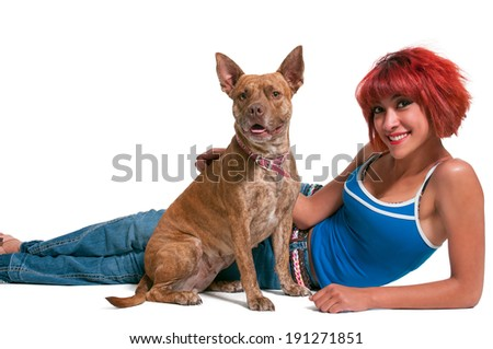 Beautiful young woman with her pit bull mix dog - stock photo