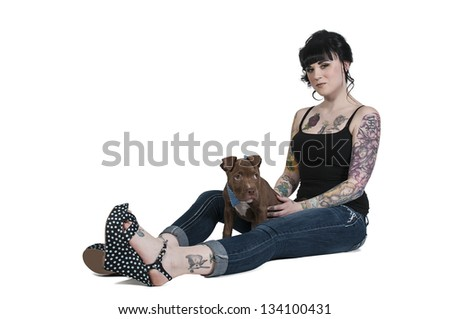 Beautiful young woman with her pit bull puppy