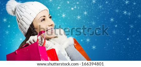 Beautiful young woman with her shopping bags - stock photo