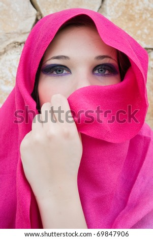 beautiful young woman with her veil around her face - stock photo
