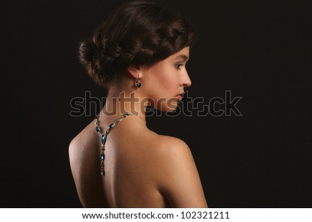 beautiful young woman with jewelry on back