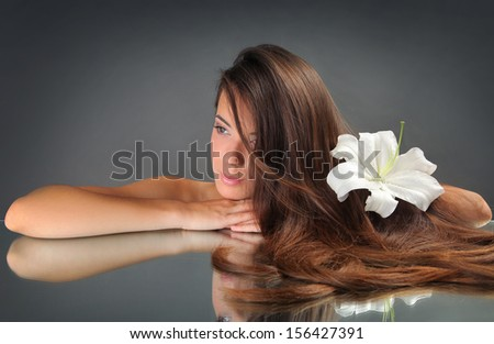 beautiful young woman with lily - stock photo