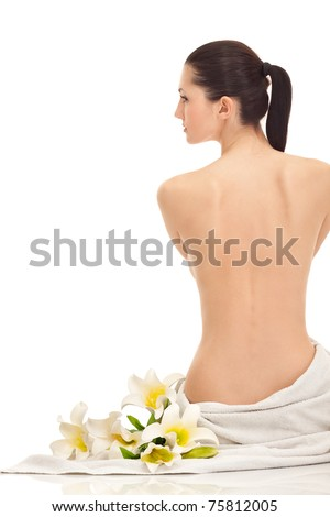 beautiful young woman with lily flowers, isolated on white, back view - stock photo
