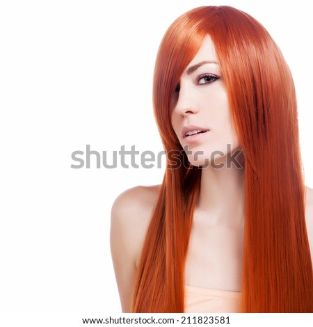 Beautiful young woman with long hair and jewelery. - stock photo