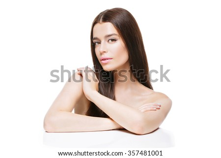 Beautiful young woman with long hair touching shoulder. Isolated over white backgound. Copy space,