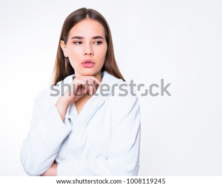 beautiful young woman with long hair wearing white bath robe