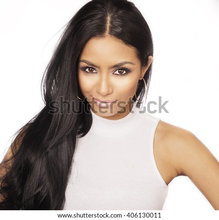 Beautiful young woman with long silky shiny dark hair - stock photo