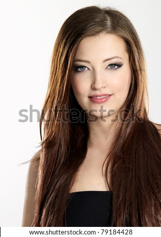 Beautiful young woman with long straight  hair - vertical - stock photo