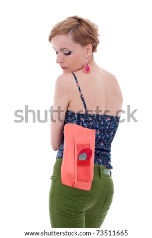 Beautiful young woman with luxury fashion handbag in her back poket - stock photo