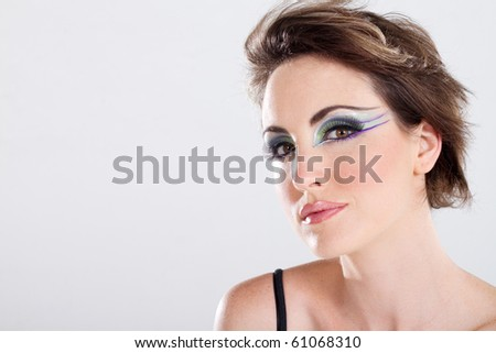 beautiful young woman with makeup, studio shot - stock photo