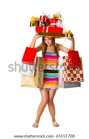 beautiful young woman with many gifts. isolated on white - stock photo