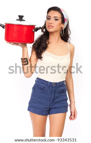 Beautiful young woman with modern Carmen Miranda look with red cooking pot isolated on a white background. - stock photo