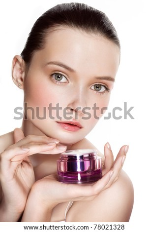 Beautiful young woman with moisturizing cream