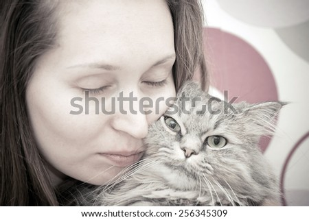 beautiful young woman  with monochrome  cat - stock photo