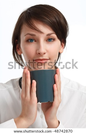 beautiful young woman with mug in hands looking straight to viewer, on white background - stock photo