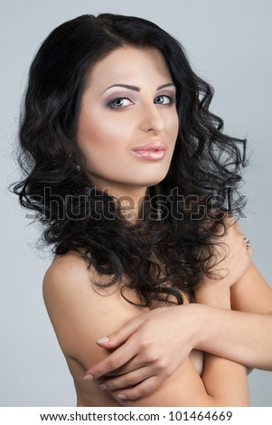 Beautiful, young woman with naked shoulders - stock photo