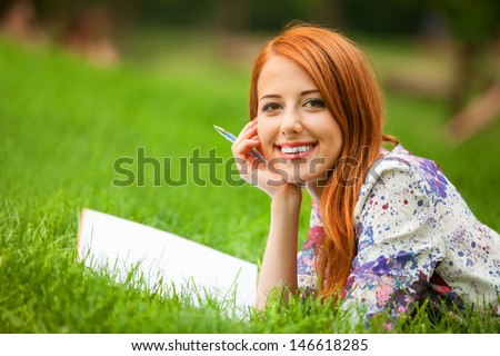 beautiful young woman with note at outdoor
